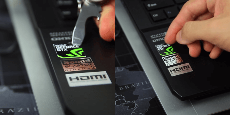 Remove stickers from laptop using nail or sharp blade